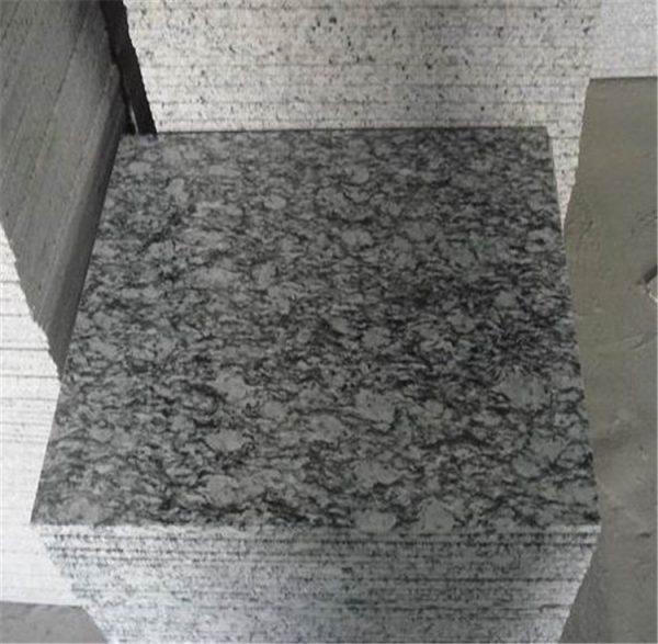 China Spary White Sea Wave White Granite Tiles